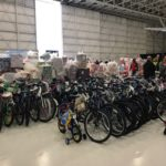 Bikes and wrapped gifts ready to be loaded onto planes