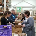 MDT Employee volunteers counting plastic grocery bags
