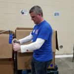Employee moving pallet of food donations - Gleaners 2019
