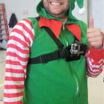 Employee in Elf Costume at Operation Good Cheer