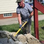 Employee using a sledgehammer