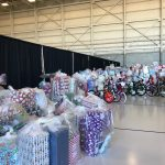 Loads of wrapped gifts in the airplane hangar
