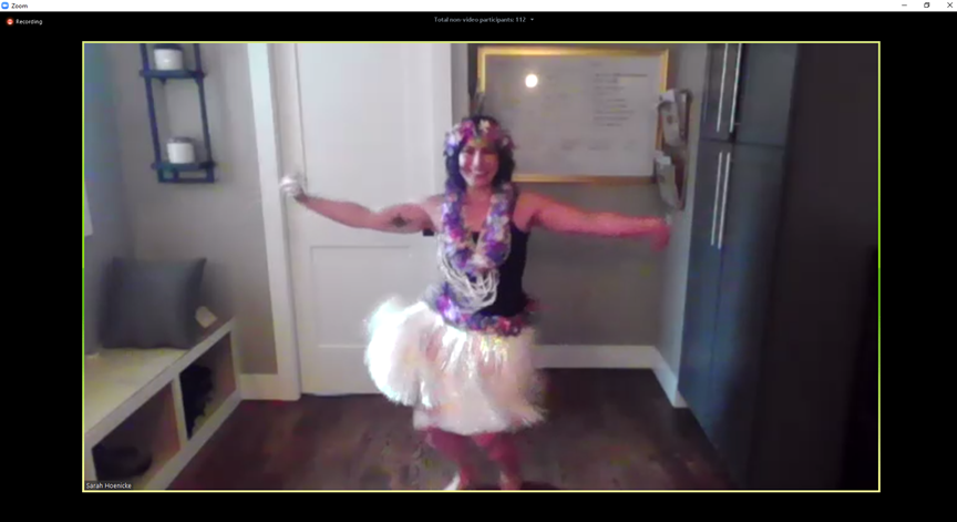 MDT employee dancing the hula
